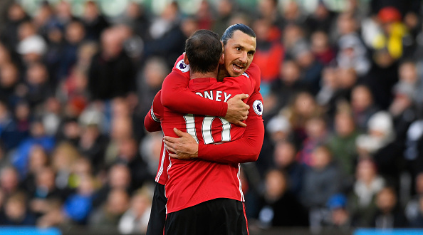 SWANSEA, WALES - NOVEMBER 06: Manchester United striker Zlatan Ibrahimovic (r) celebrates his second goal with Wayne Rooney  during the Premier League match between Swansea City and Manchester United at Liberty Stadium on November 6, 2016 in Swansea, Wales.  (Photo by Stu Forster/Getty Images)