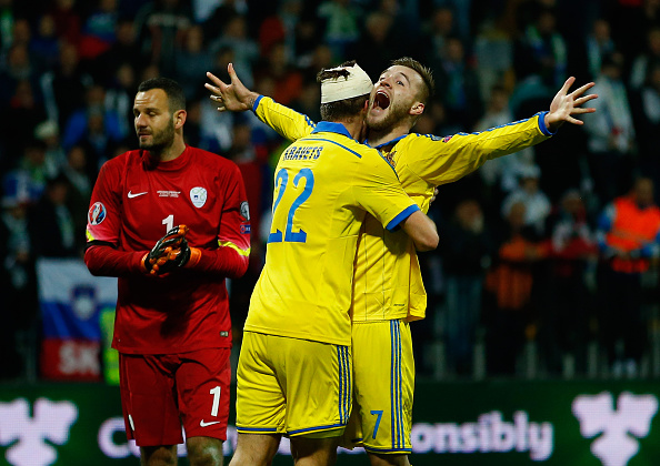 MARIBOR, SLOVENIA - NOVEMBER 17:  Andriy Yarmolenko of Ukraine celebrates his goal with Artem Kravets to qualify during the UEFA EURO 2016 qualifier play-off second leg match between Slovenia and Ukraine at Ljudski Vrt Stadium on November 17, 2015 in Maribor, Slovenia.  (Photo by Laurence Griffiths/Getty Images)