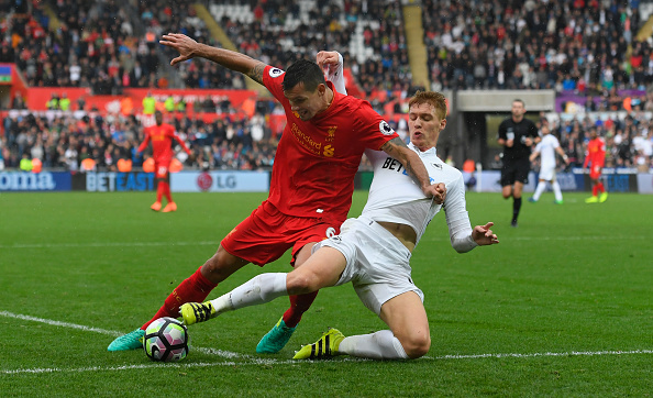 SWANSEA, WALES - OCTOBER 01:  Liverpool player Dejan Lovren (l) is challenged by Jay Fulton of Swansea during the Premier League match between Swansea City and Liverpool at Liberty Stadium on October 1, 2016 in Swansea, Wales.  (Photo by Stu Forster/Getty Images)