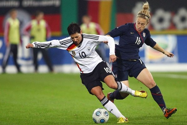 AUGSBURG, GERMANY - OCTOBER 29:  Linda Bresonik (L) of Germany and Ella Masar of USA tackle for the ball during the Women's International friendly match between Germany and USA at the Impuls Arena on October 29, 2009 in Augsburg, Germany.  (Photo by Johannes Simon/Bongarts/Getty Images)
