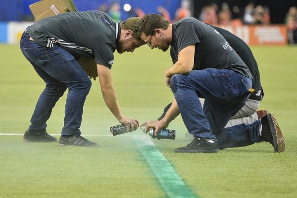 MONTREAL, QC - NOVEMBER 22:  Game delayed between the Montreal Impact and the Toronto FC due to a technical error as field crews repaint the lines during leg one of the MLS Eastern Conference finals at Olympic Stadium on November 22, 2016 in Montreal, Quebec, Canada.  (Photo by Minas Panagiotakis/Getty Images)