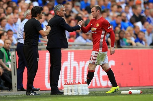 LONDON, ENGLAND - AUGUST 07:  Wayne Rooney of Manchester United shakes the hand of Manchester United manager Jose Mourinho during The FA Community Shield between Leicester City and Manchester United at Wembley Stadium on August 7, 2016 in London, England.  (Photo by Ben Hoskins/Getty Images)