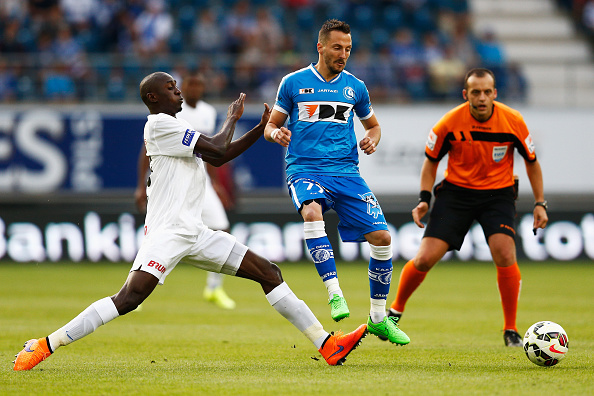 GENT, BELGIUM - JULY 31:  Danijel Milicevic of Gent battles for the ball with Wilfred Ndidi of Genk  during the Jupiler League match between KAA Gent and KRC Genk held at the Ghelamco Arena on July 31, 2015 in Gent, Belgium.  (Photo by Dean Mouhtaropoulos/Getty Images)
