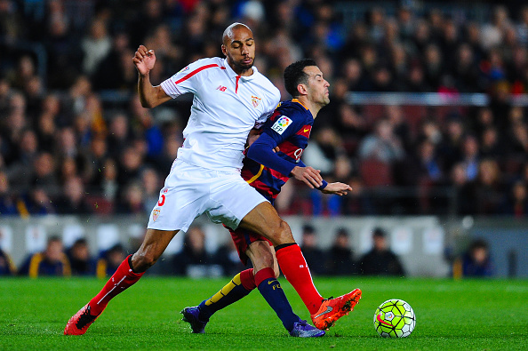 BARCELONA, SPAIN - FEBRUARY 28:  Sergio Busquets of FC Barcelona is brought down by Steven N'Zonzi of Sevilla FC during the La Liga match between FC Barcelona and Sevilla FC at Camp Nou on February 28, 2016 in Barcelona, Spain.  (Photo by David Ramos/Getty Images)