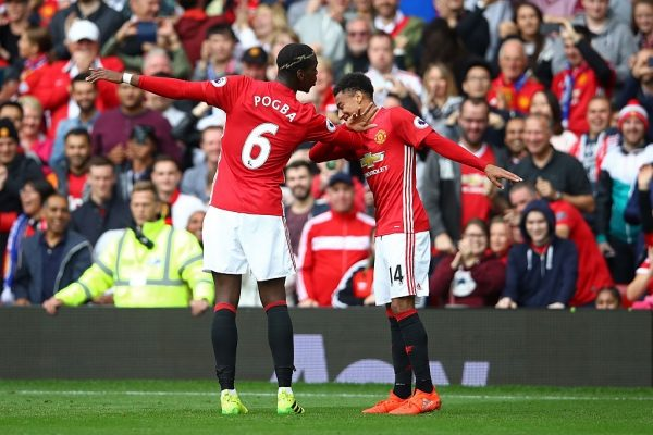 MANCHESTER, ENGLAND - SEPTEMBER 24: Paul Pogba of Manchester United (L) celebrates scoring his sides fourth goal with Jesse Lingard of Manchester United (R) during the Premier League match between Manchester United and Leicester City at Old Trafford on September 24, 2016 in Manchester, England.  (Photo by Clive Brunskill/Getty Images)