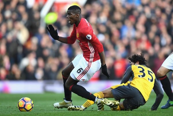 MANCHESTER, ENGLAND - NOVEMBER 19: Paul Pogba of Manchester United (L) is fouled by Mohamed Elneny of Arsenal (R) during the Premier League match between Manchester United and Arsenal at Old Trafford on November 19, 2016 in Manchester, England.  (Photo by Shaun Botterill/Getty Images)