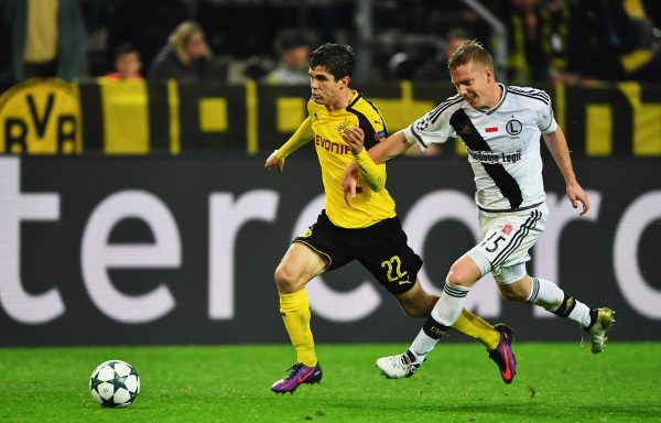 DORTMUND, GERMANY - NOVEMBER 22:  Christian Pulisic of Dortmund is challenged by Michal Kopczynski of Warsaw during the UEFA Champions League match between Borussia Dortmund and Legia Warszawa at Signal Iduna Park on November 22, 2016 in Dortmund, North Rhine-Westphalia.  (Photo by Stuart Franklin/Bongarts/Getty Images,)