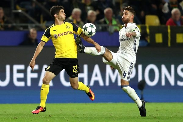 DORTMUND, GERMANY - SEPTEMBER 27:  Sergio Ramos of Real Madrid challenges Christian Pulisic of Borussia Dortmund during the UEFA Champions League Group F match between Borussia Dortmund and Real Madrid CF at Signal Iduna Park on September 27, 2016 in Dortmund, North Rhine-Westphalia.  (Photo by Alex Grimm/Bongarts/Getty Images)