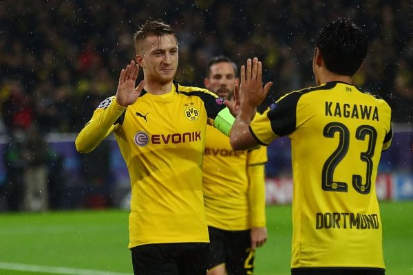 DORTMUND, GERMANY - NOVEMBER 22:  Marco Reus of Borussia Dortmund celebrates scoring his teams fifth goal with teammate Shinji Kagawa during the UEFA Champions League Group F match between Borussia Dortmund and Legia Warszawa at Signal Iduna Park on November 22, 2016 in Dortmund, North Rhine-Westphalia.  (Photo by Alex Grimm/Bongarts/Getty Images)