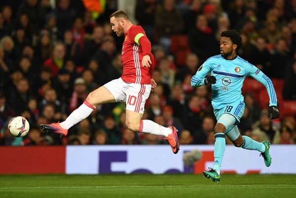 MANCHESTER, ENGLAND - NOVEMBER 24:  Wayne Rooney of Manchester United beats Miquel Nelom of Feyenoord to the ball during the UEFA Europa League Group A match between Manchester United FC and Feyenoord at Old Trafford on November 24, 2016 in Manchester, England.  (Photo by Gareth Copley/Getty Images)