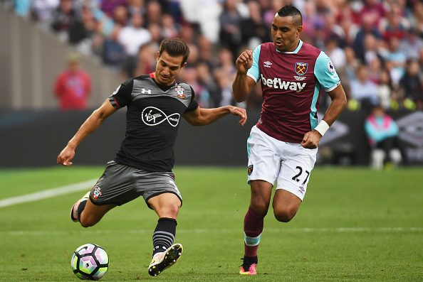 LONDON, ENGLAND - SEPTEMBER 25:  Cedric Soares of Southampton is watched by Dimitri Payet of West Ham United during the Premier League match between West Ham United and Southampton at London Stadium on September 25, 2016 in London, England.  (Photo by Mike Hewitt/Getty Images)