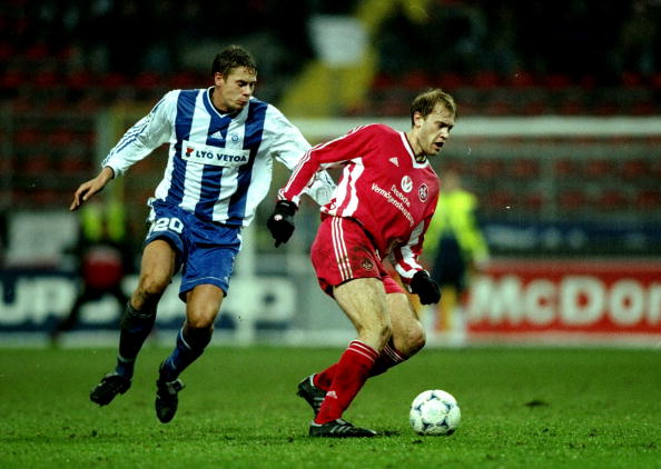 9 Dec 1998:  Marian Hristov of Kaiserslautern is watched by Mika Kottila of Helsinki during the UEFA Champions League match at the Fritz Walter Stadion in Kaiserslautern, Germany. Kaiserslautern won the match 5-2 to qualify for the last eight.  MandatoryCredit: Craig Prentis /Allsport