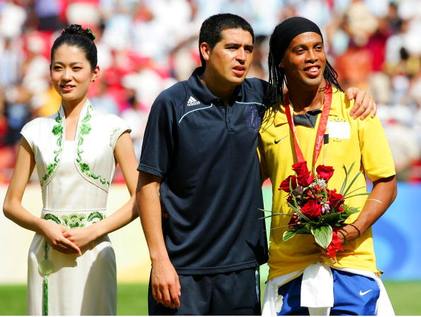 BEIJING - AUGUST 23: Juan Riquelme of Argentina and Ronaldinho of Brazil share a joke during the medal ceremony for the Men's Final between Nigeria and Argentina at the National Stadium on Day 15 of the Beijing 2008 Olympic Games on August 23, 2008 in Beijing, China.  (Photo by Koji Watanabe/Getty Images)