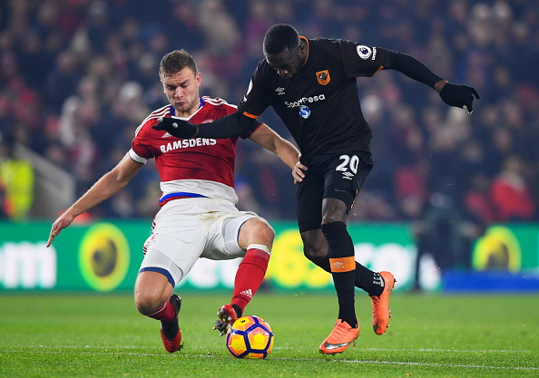 MIDDLESBROUGH, ENGLAND - DECEMBER 05:  Adama Diomande of Hull City battles with Ben Gibson of Middlesbrough during the Premier League match between Middlesbrough and Hull City at Riverside Stadium on December 5, 2016 in Middlesbrough, England.  (Photo by Stu Forster/Getty Images)