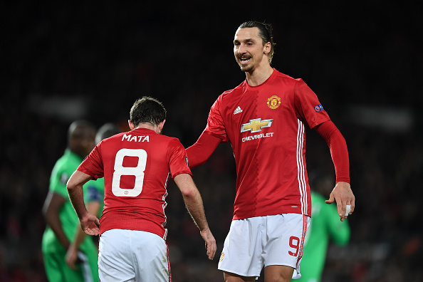 MANCHESTER, ENGLAND - FEBRUARY 16:  Zlatan Ibrahimovic of Manchester United celebrates scoring his sides first goal with Juan Mata of Manchester United during the UEFA Europa  League Round of 32 first leg match between Manchester United and AS Saint-Etienne at Old Trafford on February 16, 2017 in Manchester, United Kingdom.  (Photo by Shaun Botterill/Getty Images)
