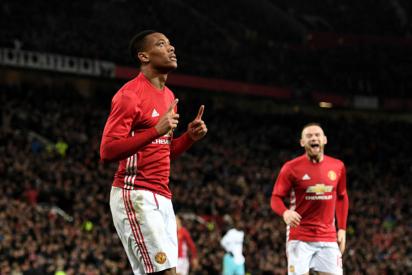 MANCHESTER, ENGLAND - NOVEMBER 30:  Anthony Martial of Manchester United celebrates after scoring his team's third goal of the game during the EFL Cup quarter final match between Manchester United and West Ham United at Old Trafford on November 30, 2016 in Manchester, England.  (Photo by Shaun Botterill/Getty Images)