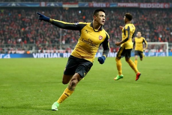 MUNICH, GERMANY - FEBRUARY 15: Alexis Sanchez of Arsenal celebrates after he scores the equalizing goal during the UEFA Champions League Round of 16 first leg match between FC Bayern Muenchen and Arsenal FC at Allianz Arena on February 15, 2017 in Munich, Germany.  (Photo by Alex Grimm/Bongarts/Getty Images)